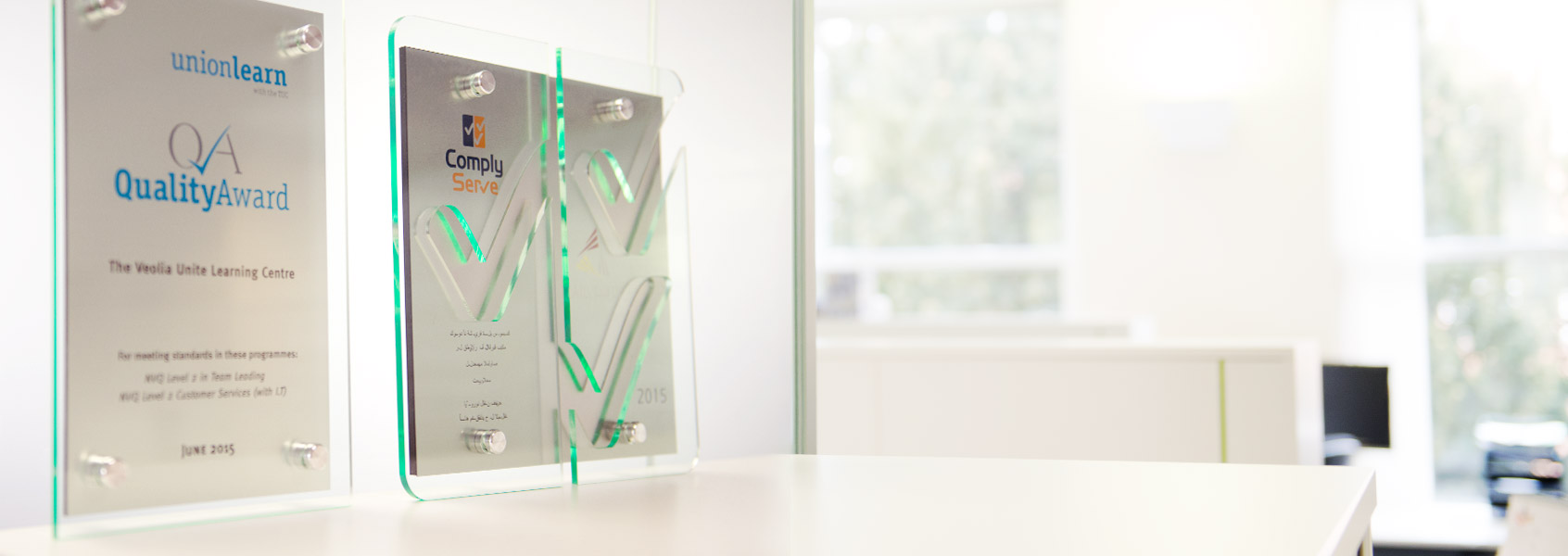 Twin layer glass effect acrylic plaque cut to bespoke shape of logo or design