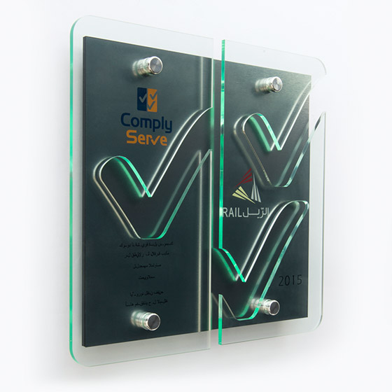 Twin layer glass effect acrylic plaque cut to bespoke shape of logo or design - green effect glass